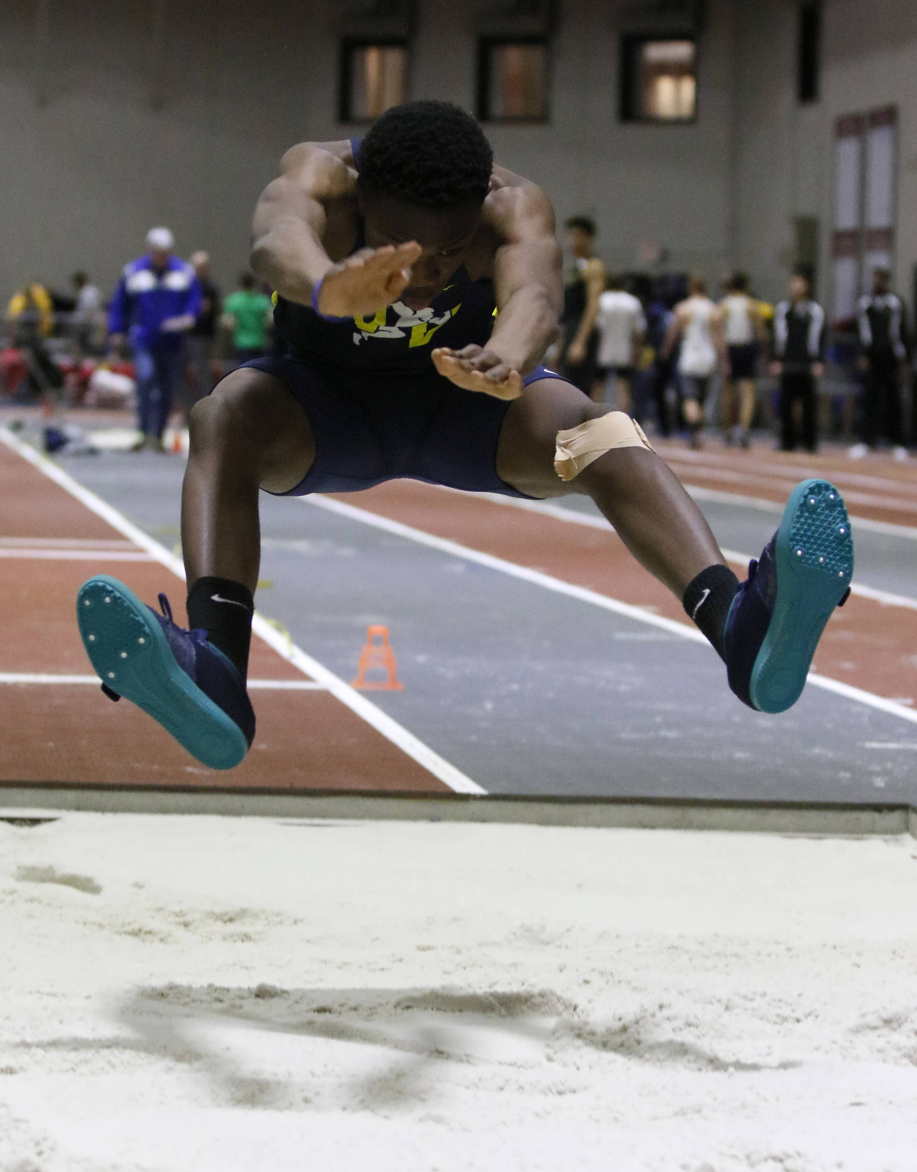Neuqua Valley's Ife Oketona competes in the long jump at the DuPage Valley Conference boys indoor track meet at North Central College.