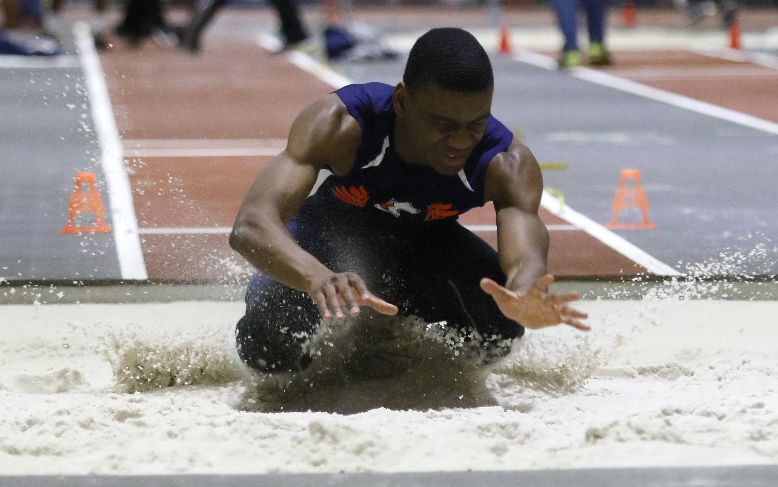 Naperville North's Doug Howard makes his long jump landing at the DuPage Valley Conference boys indoor track meet at North Central College.