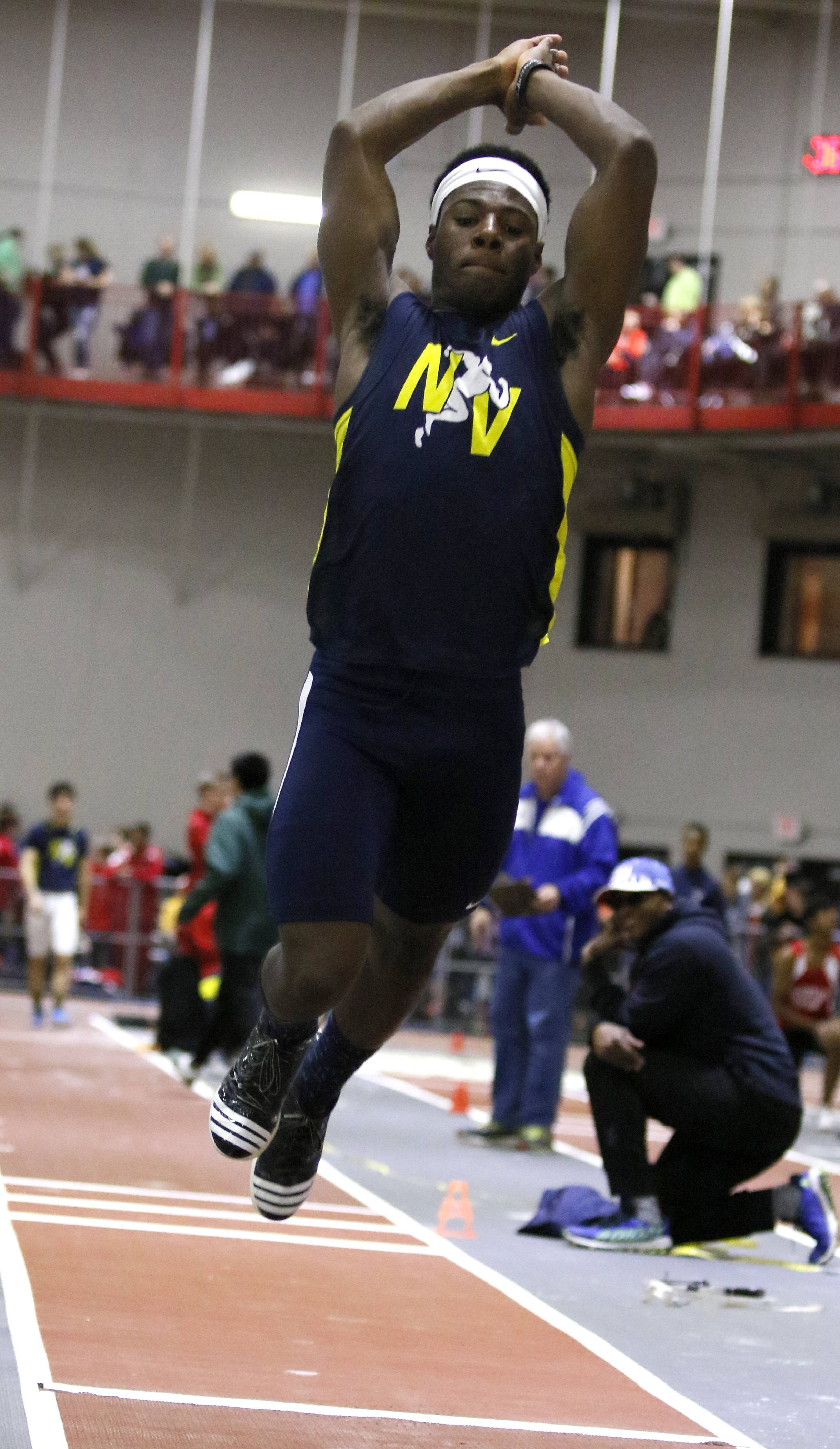 Neuqua Valley's McKenzie Mitchell competes in the triple jump at the DuPage Valley Conference boys indoor track meet at North Central College.