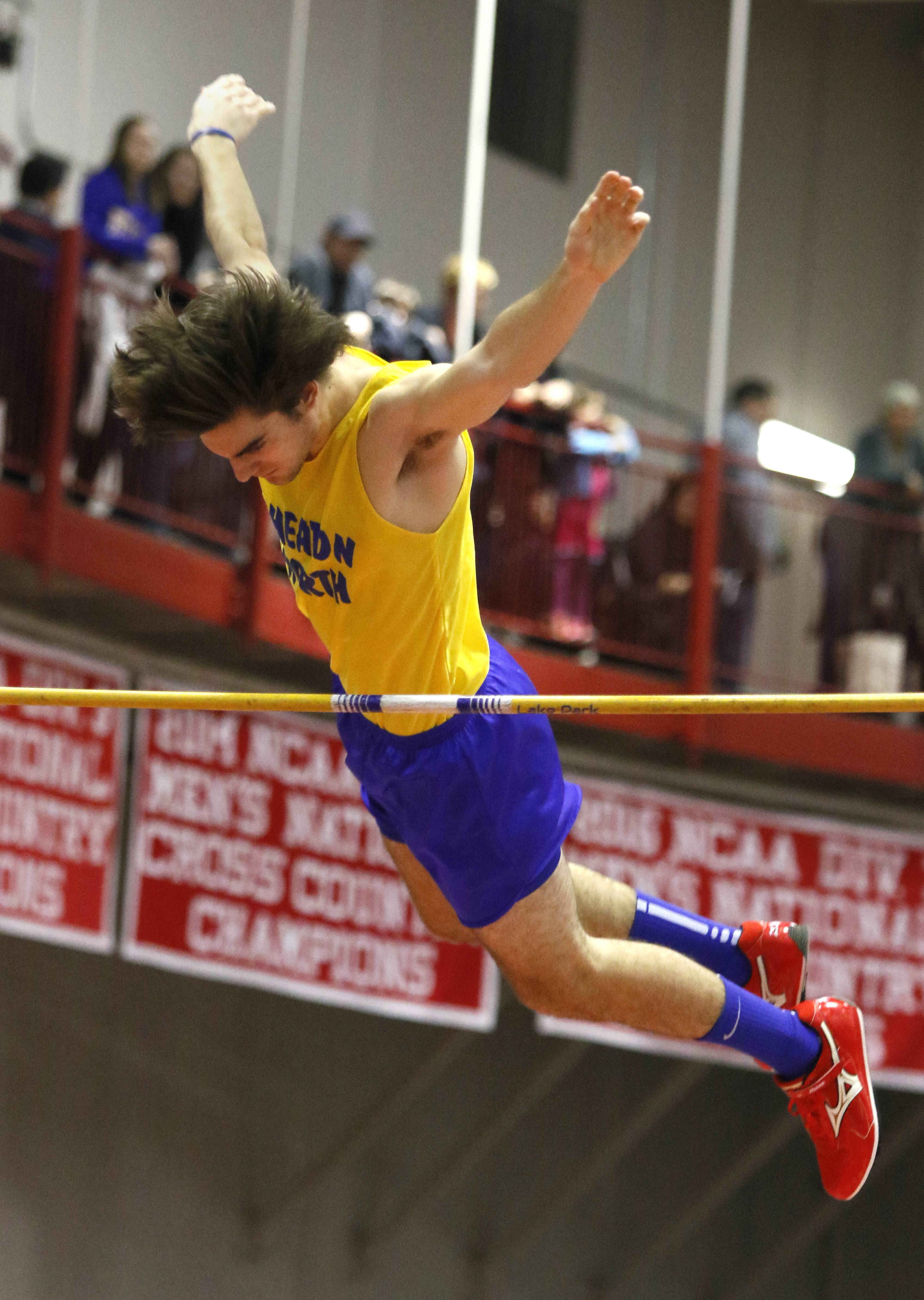 Wheaton North's Will Aguiar gets over the bar during the pole vault competition at the DuPage Valley Conference boys indoor track meet at North Central College.