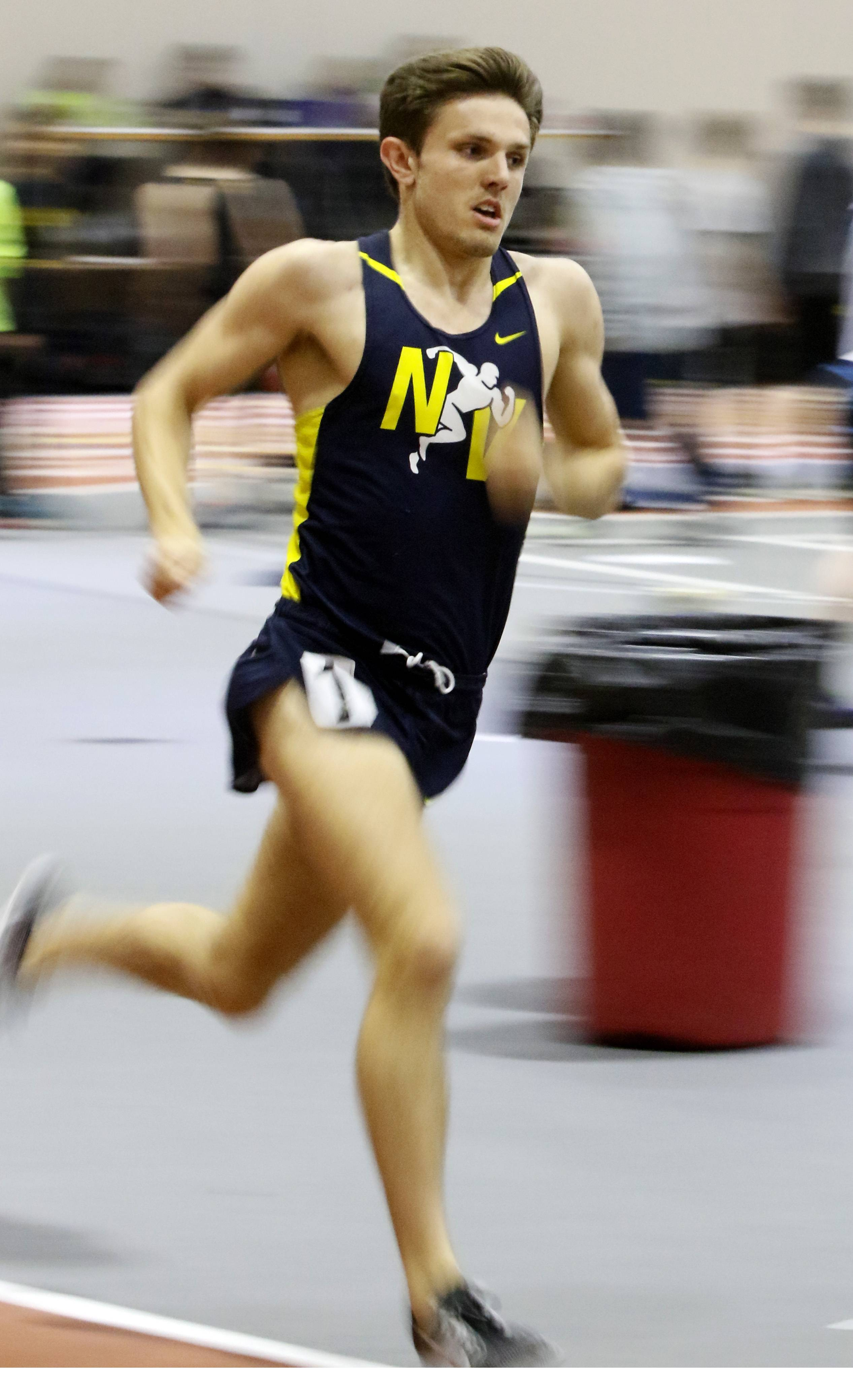 Neuqua Valley's Jake McEneaney wins the 1600 meter run at the DuPage Valley Conference boys indoor track meet at North Central College.