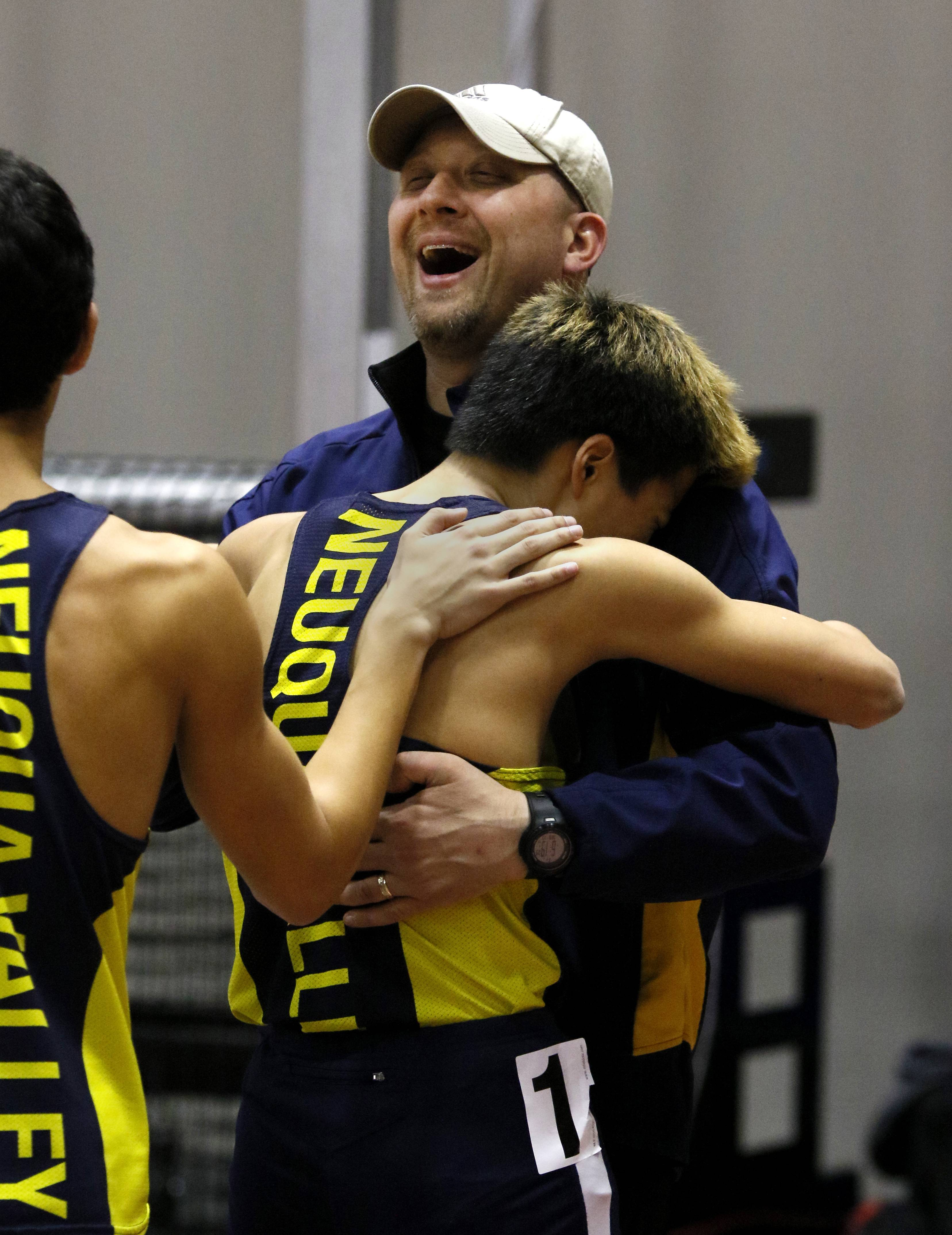 Neuqua Valley's Alan Poe is congratulated after anchoring a first place finish in the 4x800 meter relay at the DuPage Valley Conference boys indoor track meet at North Central College.