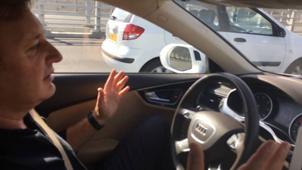 Ziv Aviram, CEO of Mobileye, rides in a semiautonomous car in Jerusalem. Israeli company Mobileye develops Advance Driver Assistance Systems for two dozen auto manufacturers worldwide.