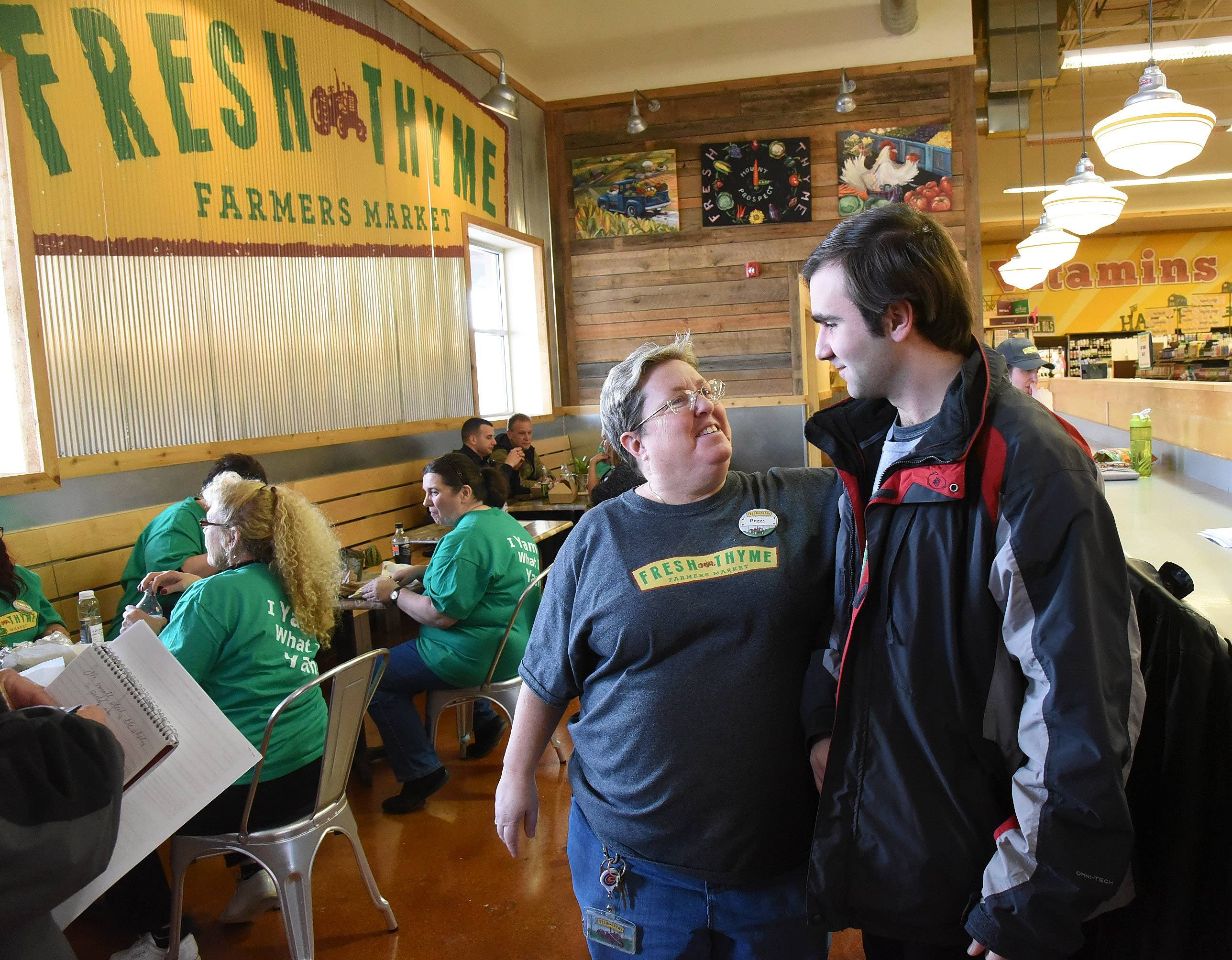 Once resistant to change and meeting new people as a result of his autism, Ben Nicholas has improved his social skills and made friends at the Fresh Thyme Farmers Market in Mount Prospect. Ready to move on to a career in manufacturing, he shares a moment with Peggy Doyle, a manager at the store, on his 22nd birthday.