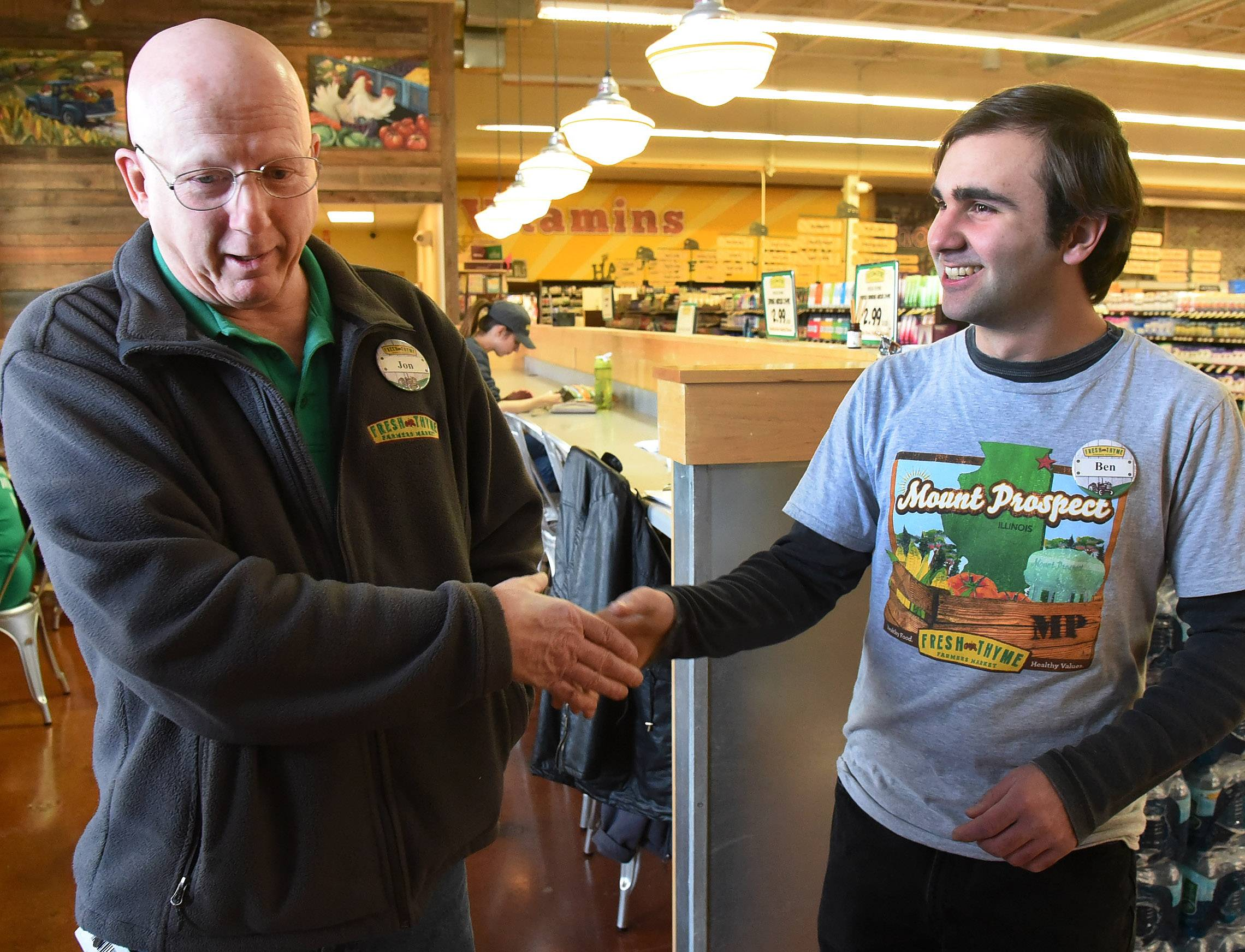 Not only did Ben Nicholas, right, learn social skills through his part-time job at Fresh Thyme Farmers Market in Mount Prospect, the Mount Prospect man was an excellent and happy worker, says store director Jon Little, left. The grocery is one of several suburban businesses that hires students from the North Suburban Special Education Organization.