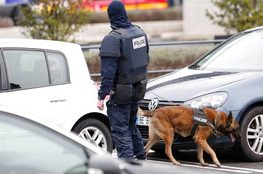 An elite police officer patrols with a police dog at the Orly airport, south of Paris, Saturday, March, 18, 2017. A man was shot to death Saturday after trying to seize the weapon of a soldier guarding Paris' Orly Airport, prompting a partial evacuation of the terminal, police said.