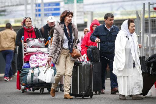 Travelers are walking back to Orly airport, south of Paris, as flights are gradually resuming, Saturday, March, 18, 2017. Soldiers at Paris' busy Orly Aiport shot and killed a man who wrestled one of their colleagues to the ground and tried to steal her rifle Saturday, officials said.