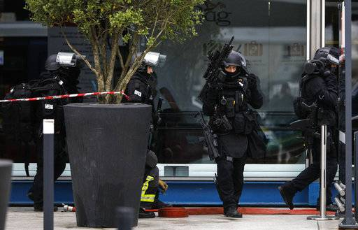 French police forces patrol at Orly airport, south of Paris, Saturday, March, 18, 2017. Soldiers at Paris' busy Orly Aiport shot and killed a man who wrestled one of their colleagues to the ground and tried to steal her rifle Saturday, officials said.