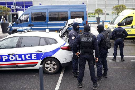 French police forces stand outside Orly airport, south of Paris, Saturday, March, 18, 2017. Soldiers at Paris' busy Orly Aiport shot and killed a man who wrestled one of their colleagues to the ground and tried to steal her rifle Saturday, officials said.
