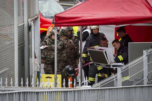 Soldiers and rescue workers work at Orly airport, south of Paris, Saturday, March, 18, 2017. A man was shot to death Saturday after trying to seize the weapon of a soldier guarding Paris' Orly Airport, prompting a partial evacuation of the terminal, police said.
