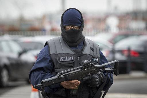 An elite police officer patrols at Orly airport, south of Paris, Saturday, March, 18, 2017. A man was shot to death Saturday after trying to seize the weapon of a soldier guarding Paris' Orly Airport, prompting a partial evacuation of the terminal, police said.