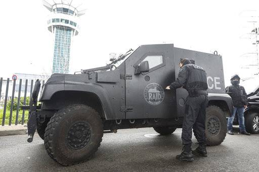 A member of the RAID, (Research, Assistance, Intervention and Deterrence), France's elite police force, exits his vehicle at Orly airport, south of Paris, Saturday, March, 18, 2017. A man was shot to death Saturday after trying to seize the weapon of a soldier guarding Paris' Orly Airport, prompting a partial evacuation of the terminal, police said.