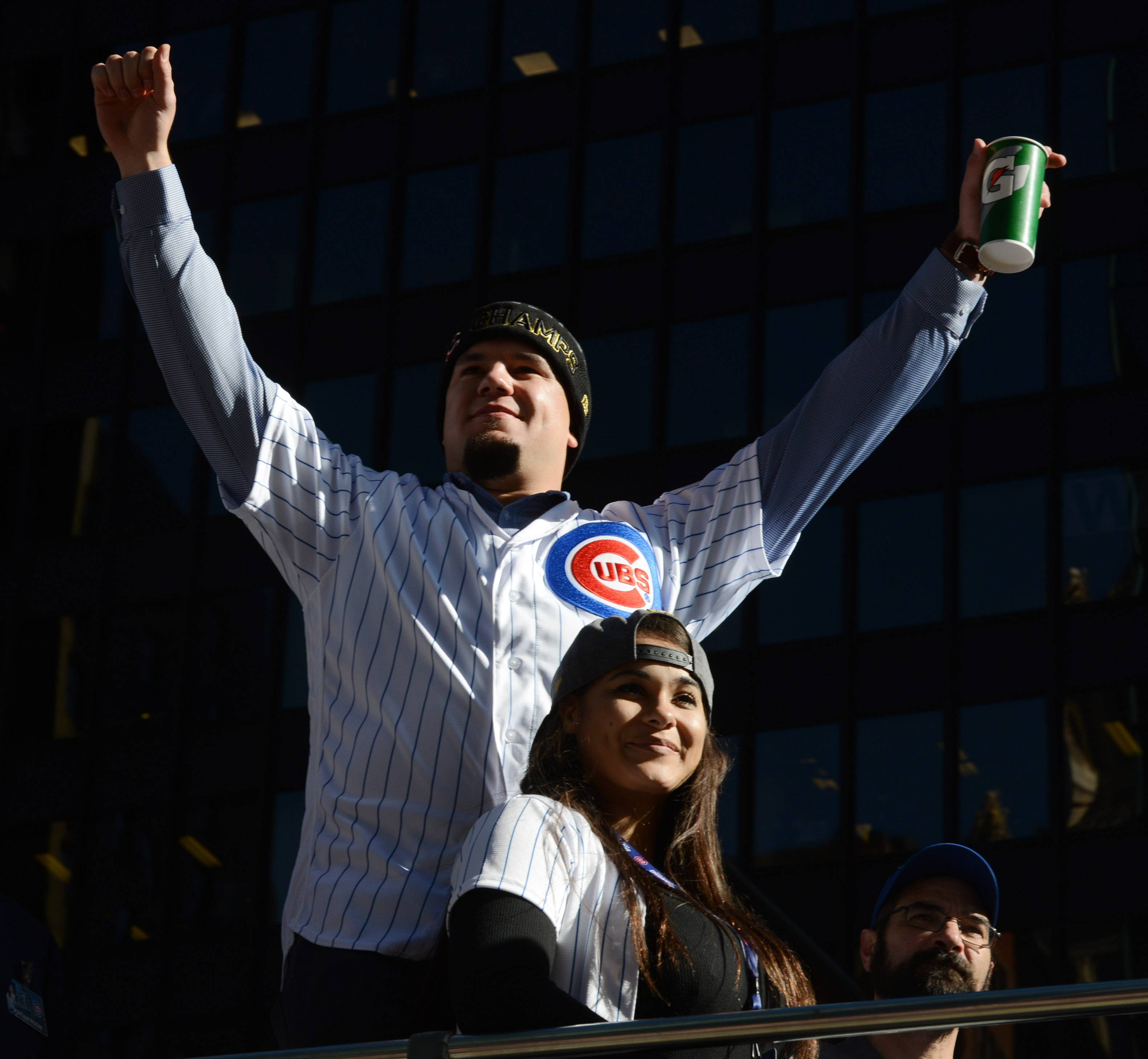 Kyle Schwarber waves to Chicago Cubs fans during the parade for the World Series champions that traveled down Michigan Avenue.