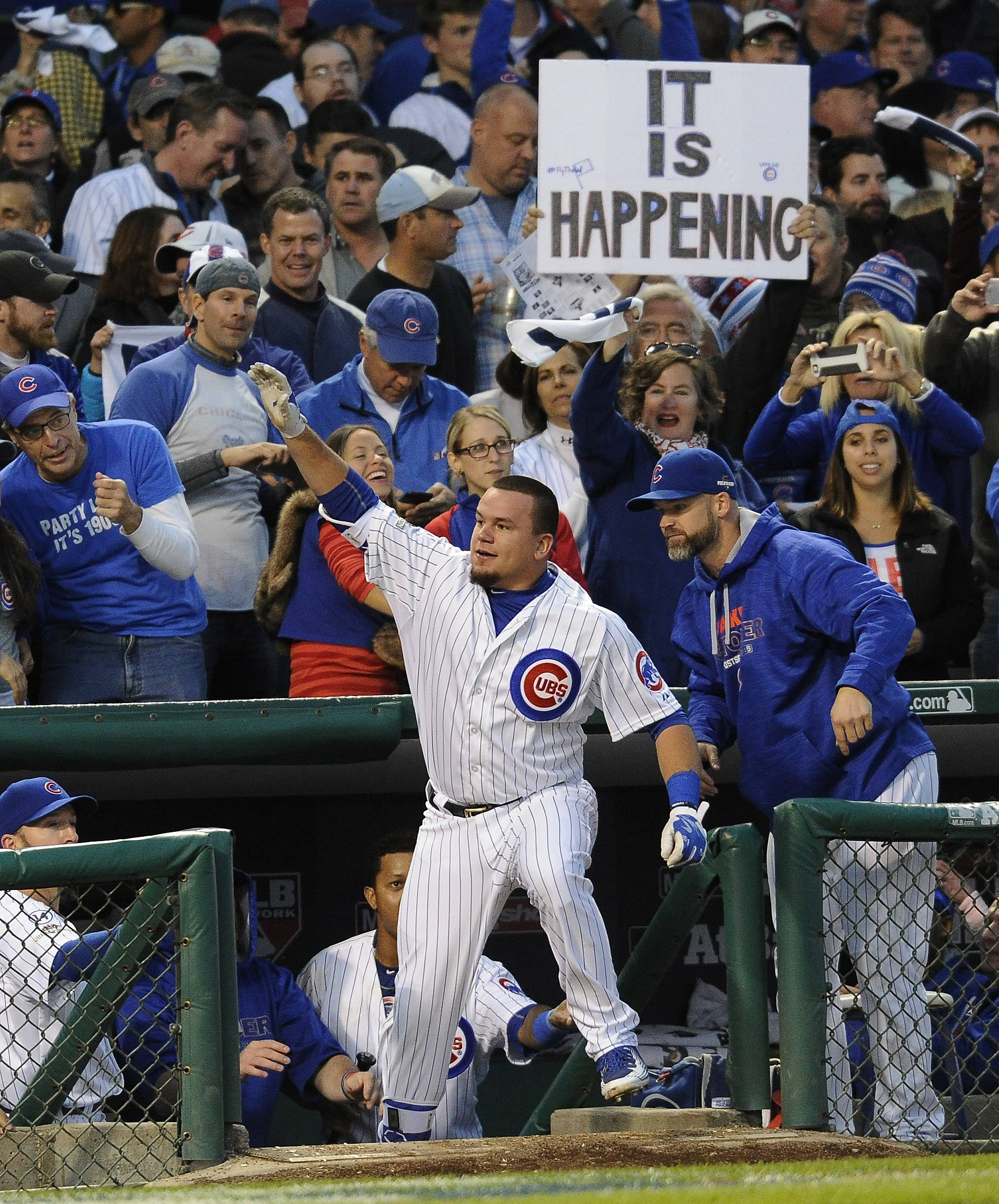 Kyle Schwarber celebrates after hitting a massive home run in bottom of the seventh inning as the Cubs beat the Cardinals 6-4 in Chicago on Oct. 13, 2015 to clinch the National League divisional series.