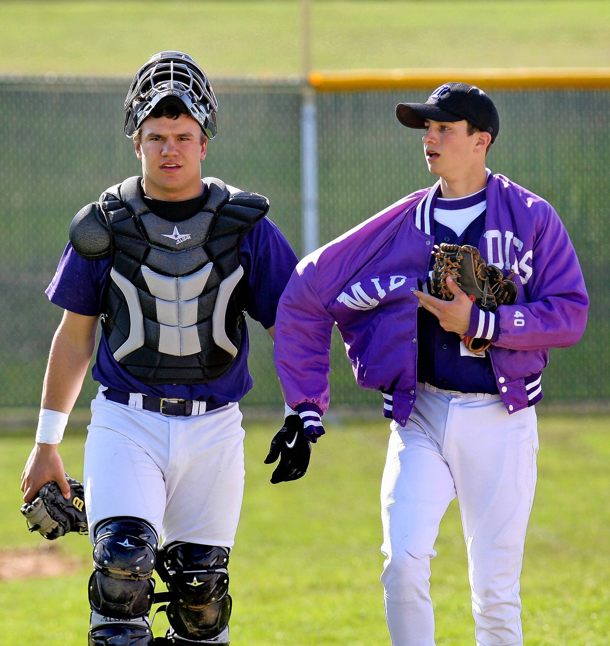 Middletown senior catcher Kyle Schwarber walks teammate Nick Henry to the dugout in game against Lakota West on April 6, 2011. That season, Schwarber led the Greater Miami Conference with a .474 batting average and a .643 on-base percentage.