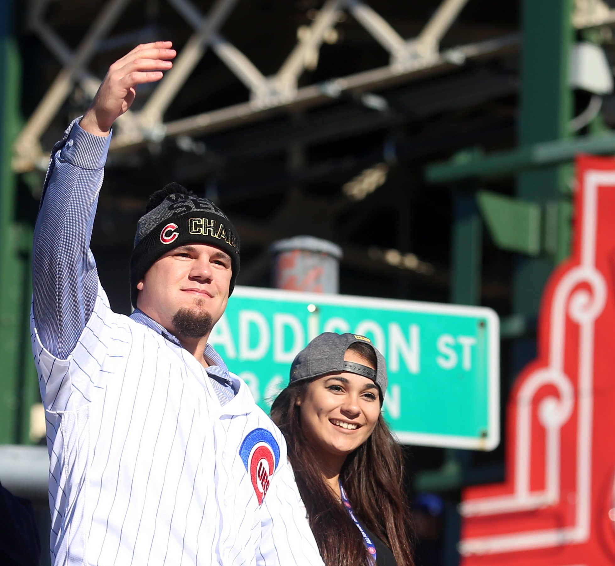 Kyle Schwarber gets the crowd revved up as the World Series champion Chicago Cubs enjoy the start of a parade that began at Wrigley Field.