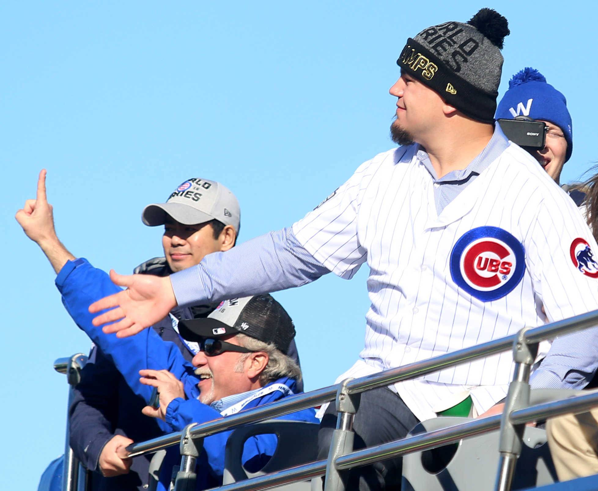 Kyle Schwarber gets the crowd revved up during the parade for the World Series champion Chicago Cubs.
