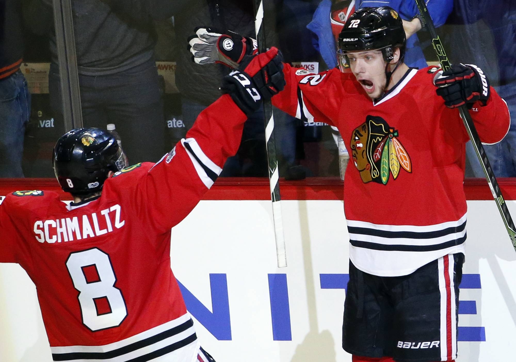 Chicago Blackhawks left wing Artemi Panarin, right, reacts as he celebrates with center Nick Schmaltz after scoring his goal against the Colorado Avalanche during the third period of an NHL hockey game Sunday, March 19, 2017, in Chicago. The Blackhawks won 6-3. (AP Photo/Nam Y. Huh)
