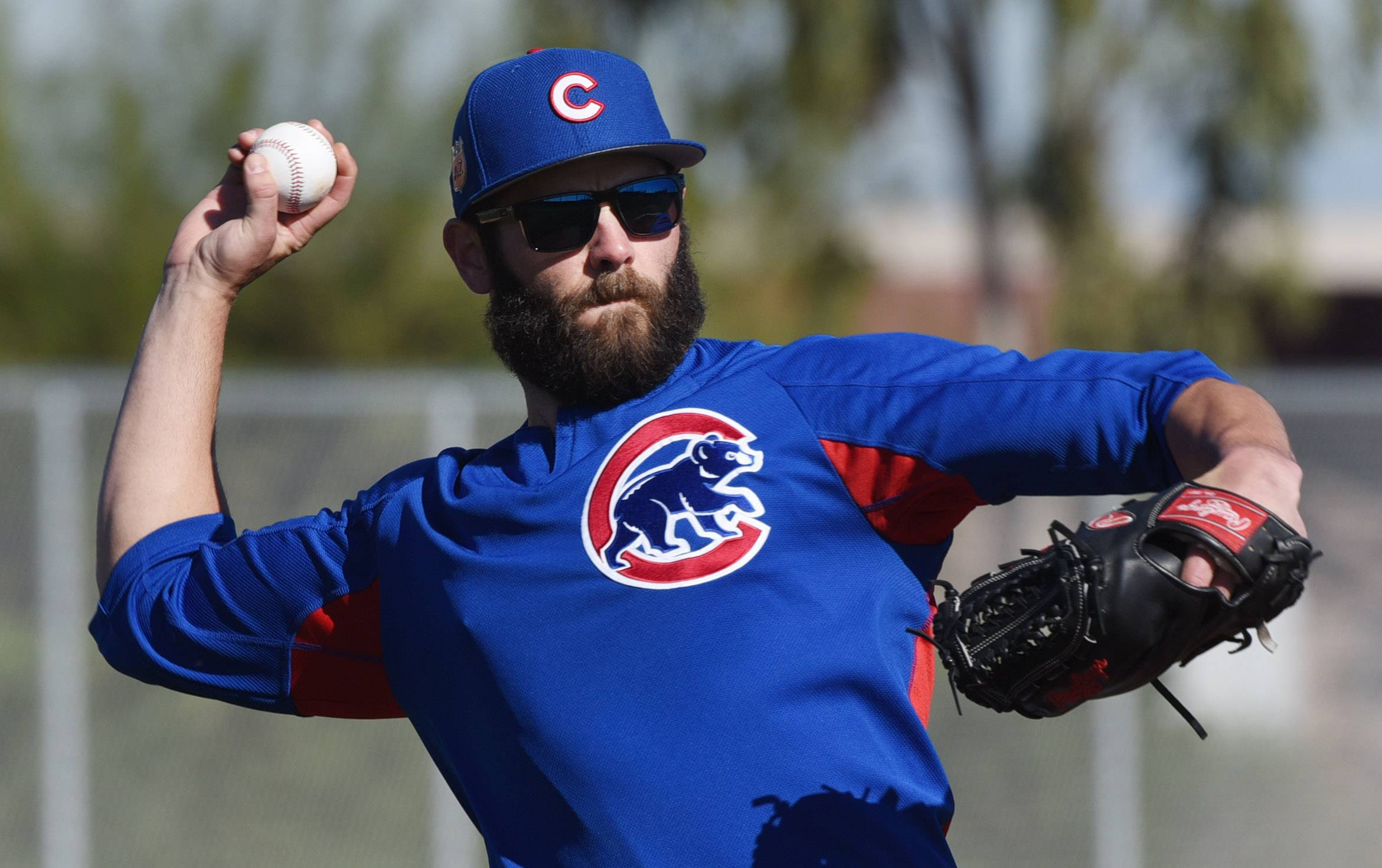 Joe Lewnard/jlewnard@dailyherald.com Chicago Cubs pitcher Jake Arrieta throws to first during a drill at Sloan Park in Mesa, Arizona Friday.