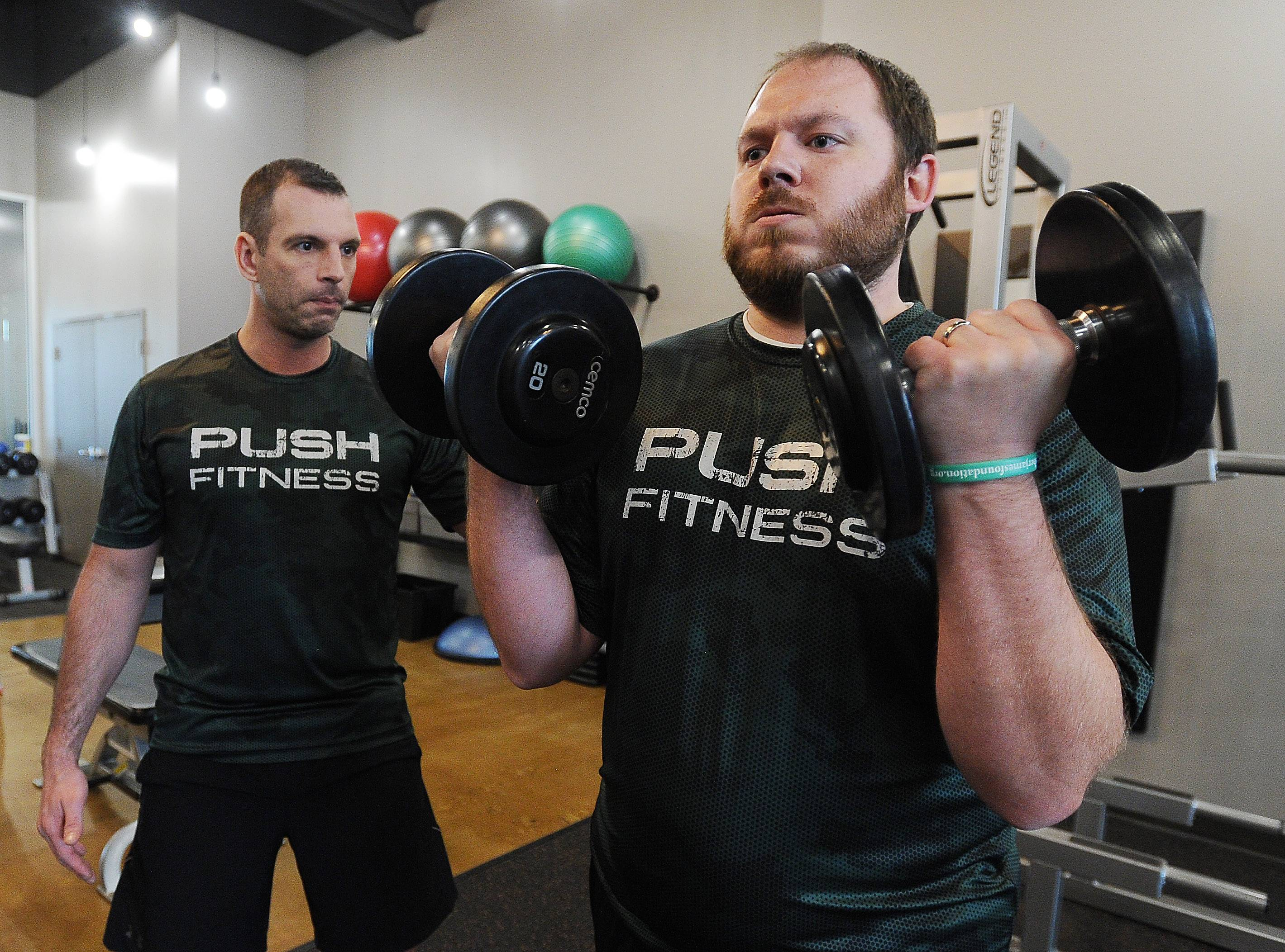 Fittest Loser contestant James DeBouver, who served in the Army, builds strength with trainer Steve Amsden.
