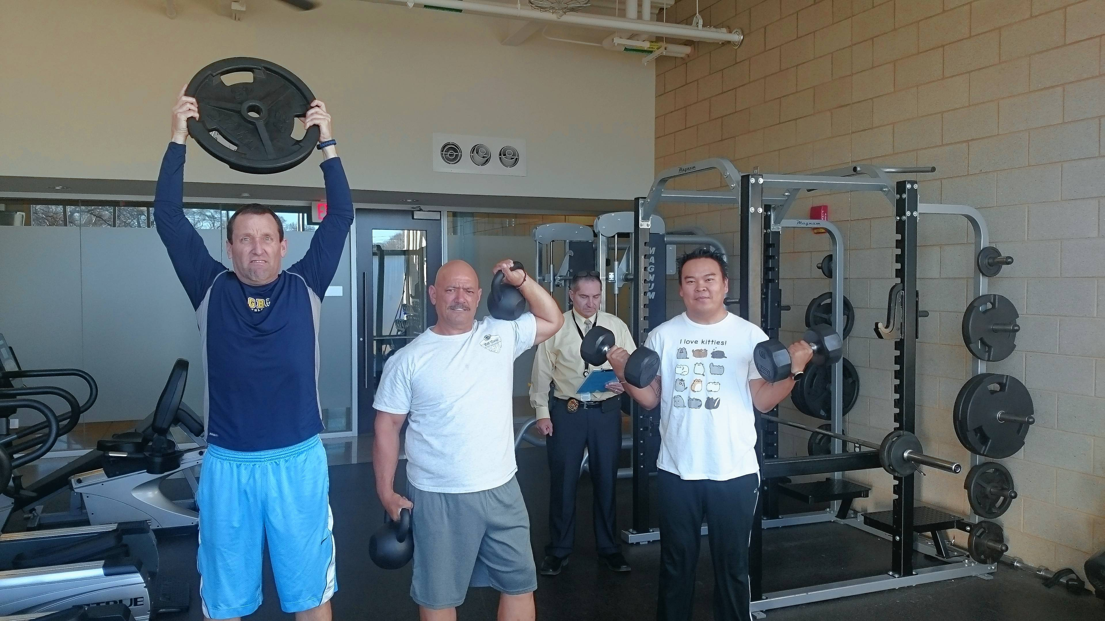 George Sullivan, Chuck Plaia, Dan Granias and Roel Aganon of Team Pounds for Blue II from Hanover Park Police Department work out under the watchful eye of Investigator Dan Granias. By working out together and having one member monitoring, everyone has no option but to give it 100 percent.