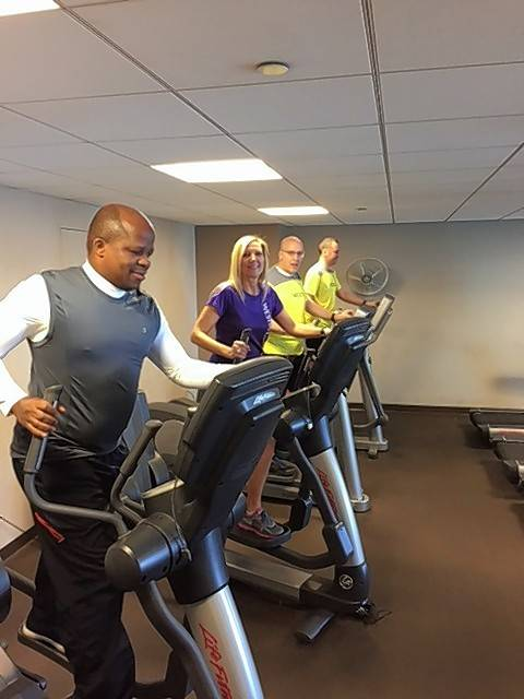 Selawe Tau, from left, Diane Wnek, Mike Feigenbaum and Paul Apanavicius of Team Westin Elephants of Westin Lombard Yorktown Center. work out at the fitness center of the hotel.