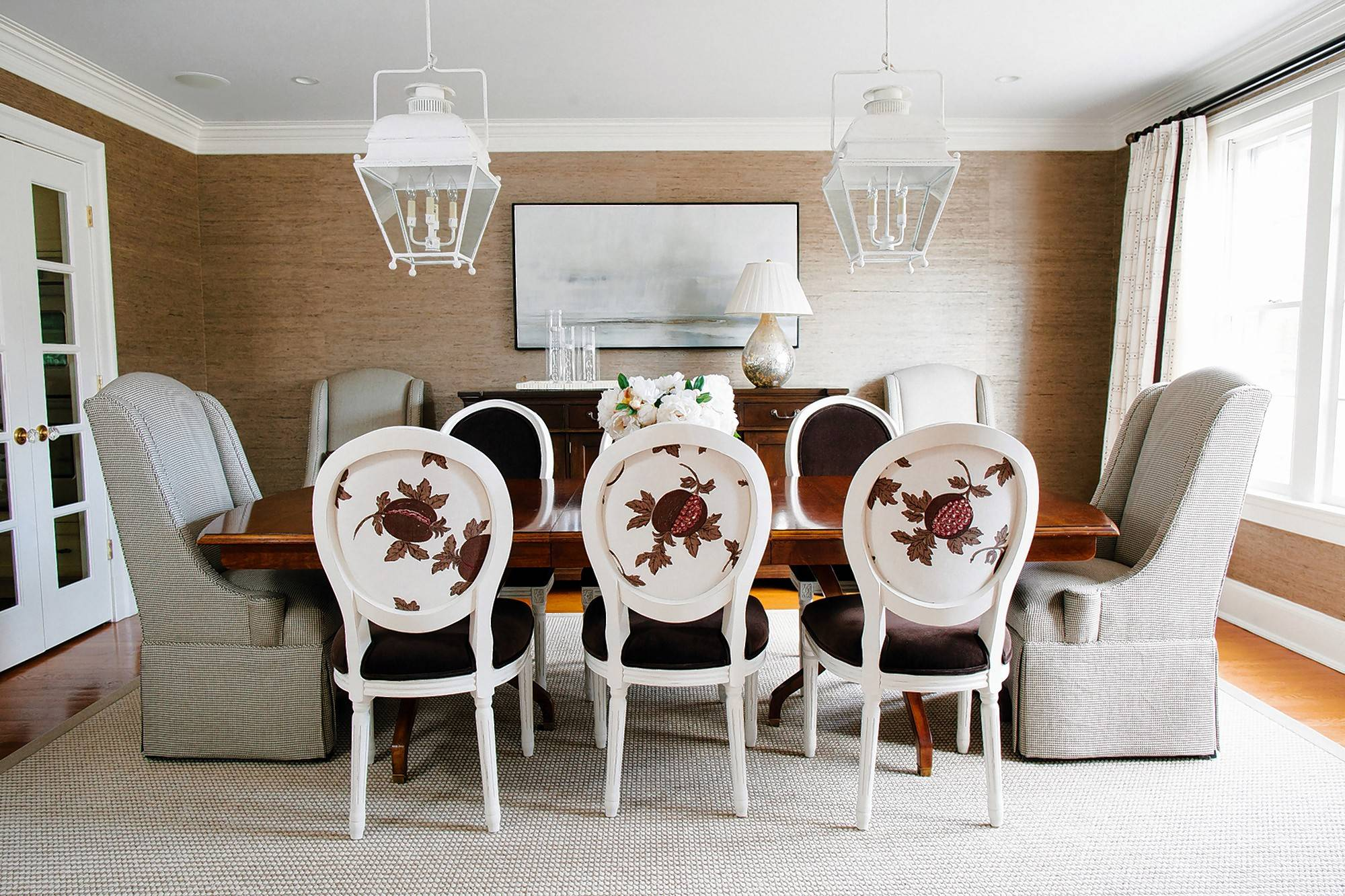 A dining room in Potomac, Maryland, designed by Erica Burns has Restoration Hardware side chairs upholstered in two different fabrics.