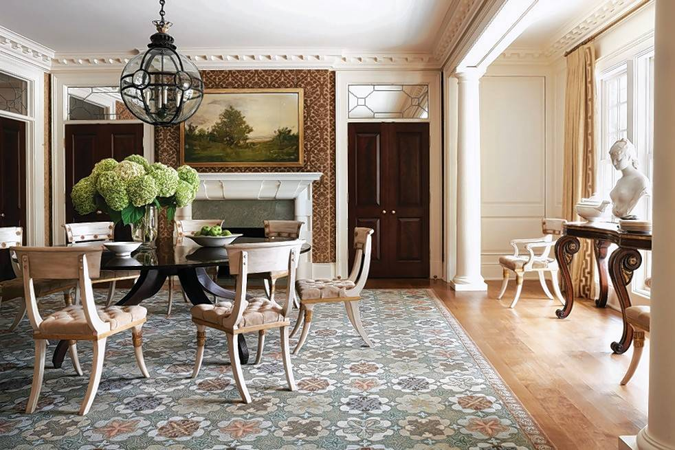 A McLean dining room designed by Thomas Pheasant has classical details, with walls upholstered in velvet damask.