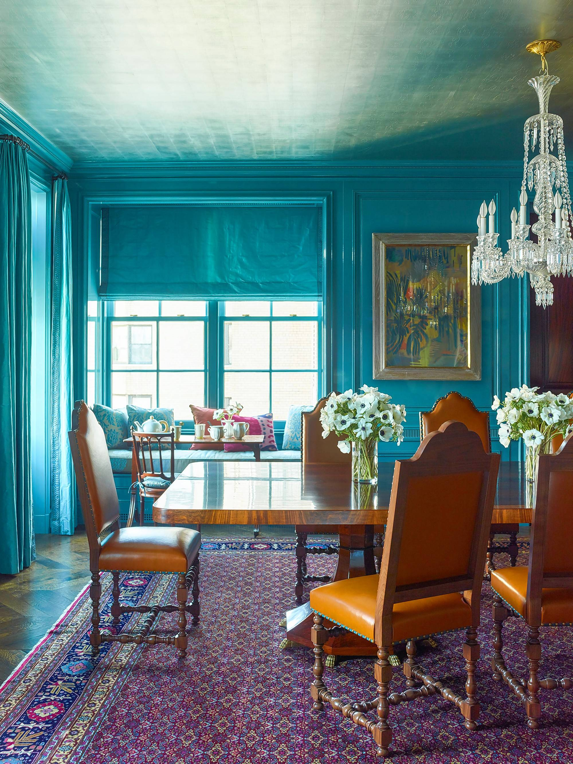 Katie Ridder updates a historic apartment in Manhattan with turquoise lacquered walls and a silver-leaf ceiling.