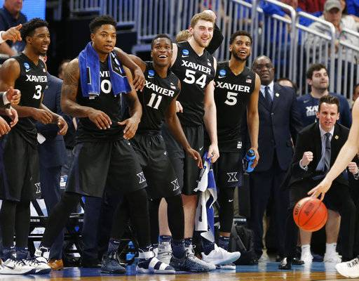 Xavier stand in front of the bench during the final seconds against Florida State in a second-round NCAA men's college basketball tournament game Saturday, March 18, 2017, in Orlando, Fla. Xavier won 91-66. (AP Photo/Wilfredo Lee)
