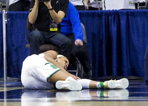 Notre Dame's Brianna Turner reacts to a knee injury during the first half of a second-round game against Purdue in the NCAA women's college basketball tournament, Sunday, March 19, 2017, in South Bend, Ind. (AP Photo/Robert Franklin)