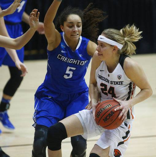 Creighton's Jaylyn Agnew (5) tries to stop Oregon State's Sydney Wiese (24) from getting to the basket during the first half of a second-round game in the women's NCAA college basketball tournament Sunday, March 19, 2017, in Corvallis, Ore. (AP Photo/ Timothy J. Gonzalez)