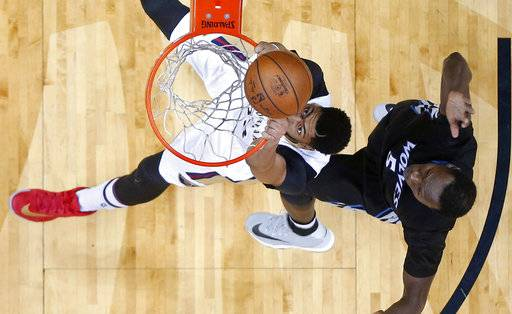 New Orleans Pelicans forward Anthony Davis watches the ball bounce off the rim on an attempted slam dunk in front of Minnesota Timberwolves forward Gorgui Dieng (5) in the first half of an NBA basketball game in New Orleans, Sunday, March 19, 2017. (AP Photo/Gerald Herbert)