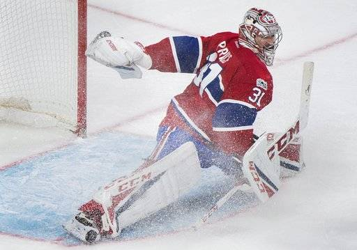 Montreal Canadiens goaltender Carey Price makes a save against the Ottawa Senators during the second period of an NHL hockey game in Montreal, Sunday, March 19, 2017. (Graham Hughes/The Canadian Press via AP)