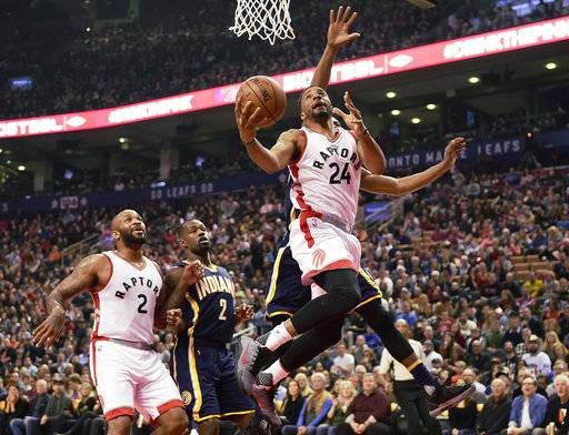 Toronto Raptors guard Norman Powell (24) drives as forward P.J. Tucker (2) and Indiana Pacers guard Rodney Stuckey (2) look on during the first half of an NBA basketball game in Toronto on Sunday, March 19, 2017. (Frank Gunn/The Canadian Press via AP)