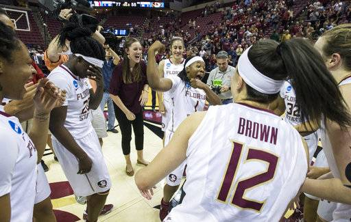Florida State celebrates at mid-court after defeating Missouri 77-55 a second-round game of the NCAA women's college basketball tournament in Tallahassee, Fla., Sunday, March 19, 2017. (AP Photo/Mark Wallheiser)