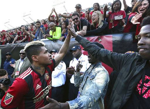 Atlanta United forward Josef Martinez celebrates with fans after scoring two goals against the Chicago Fire in an MLS soccer match Saturday, March 18, 2017, in Atlanta. (Curtis Compton/Atlanta Journal-Constitution via AP)