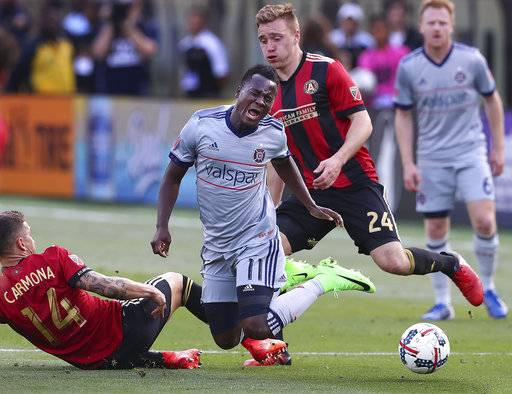 \Chicago Fire forward David Accam turns the ball over on a double-team by Atlanta United defenders Carlos Carmona, left, and Julian Gressel during the second half of an MLS soccer match Saturday, March 18, 2017, in Atlanta. (Curtis Compton/Atlanta Journal-Constitution via AP)