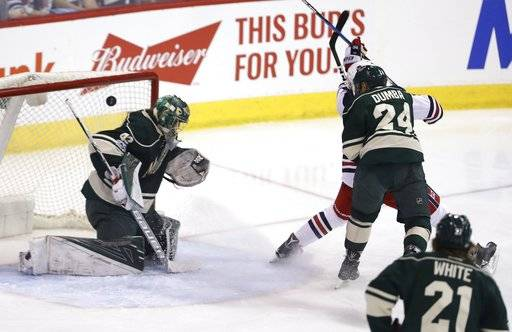 Winnipeg Jets' Andrew Copp, right rear, scores on Minnesota Wild goaltender Devan Dubnyk (40) as Wild's Matt Dumba (24) defends during the first period of an NHL hockey game in Winnipeg, Manitoba, Sunday, March 19, 2017. (Trevor Hagan/The Canadian Press via AP)