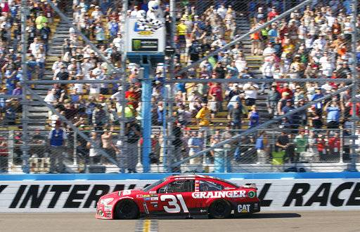Ryan Newman takes the checkered flag to win the NASCAR Cup Series auto race at Phoenix International Raceway, Sunday, March. 19, 2017, in Avondale, Ariz.