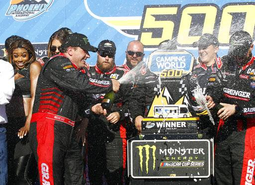 Ryan Newman, left, celebrates with his crew in Victory Lane after winning the NASCAR Cup Series auto race at Phoenix International Raceway, Sunday, March 19, 2017, in Avondale, Ariz.