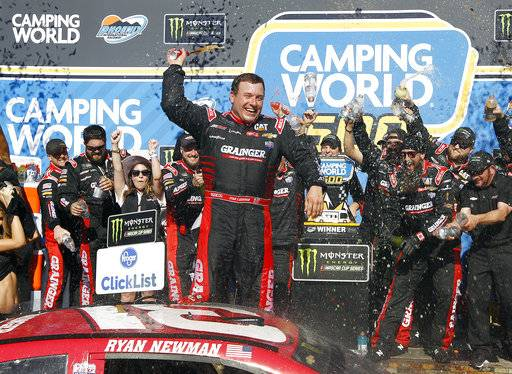 Ryan Newman celebrates in Victory Lane after winning the NASCAR Cup Series auto race at Phoenix International Raceway, Sunday, March 19, 2017, in Avondale, Ariz.