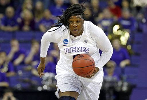 Washington's Chantel Osahor drives upcourt after stealing the ball from Montana State during the first half of a first-round game in the NCAA women's college basketball tournament Saturday, March 18, 2017, in Seattle. (AP Photo/Elaine Thompson)