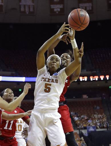 Texas forward Jordan Hosey (5) and North Carolina State forward Chelsea Nelson, right, reach for a rebound during a second-round game in the NCAA women's college basketball tournament, Sunday, March 19, 2017, in Austin, Texas. (AP Photo/Eric Gay)