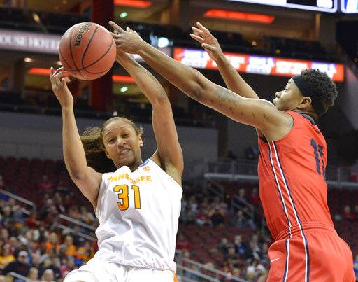 Tennessee's Jaime Nared (31) battles Dayton's Alex Harris (11) for a rebound in the first half of a first-round game in the women's NCAA college basketball tournament, Saturday, March 18, 2017, in Louisville, Ky. Louisville won 82-62.