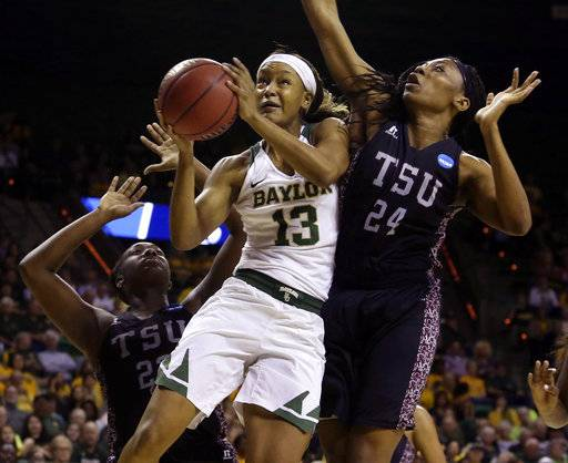 Baylor forward Nina Davis (13) drives between Texas Southern center Artavia Ford (24) and forward Breasia McElrath (22) in the first half of a first-round game in the women's NCAA college basketball tournament, Saturday, March 18, 2017, in Waco, Texas. (AP Photo/Jerry Larson)
