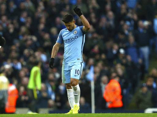 Manchester City's Sergio Aguero celebrates after scoring his side's first goal during the English Premier League soccer match between Manchester City and Liverpool at the Etihad Stadium in Manchester, England, Sunday March 19, 2017.