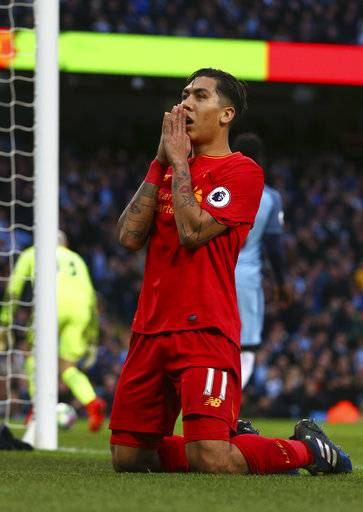 Liverpool's Roberto Firmino reacts after a missed chance to score during the English Premier League soccer match between Manchester City and Liverpool at the Etihad Stadium in Manchester, England, Sunday March 19, 2017.