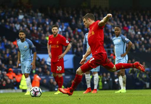 Liverpool's James Milner scores the opening goal from the penalty spot during the English Premier League soccer match between Manchester City and Liverpool at the Etihad Stadium in Manchester, England, Sunday March 19, 2017.