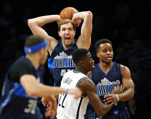Dallas Mavericks forward Dirk Nowitzki (41) looks to pass in the first half of an NBA basketball game against the Brooklyn Nets, Sunday, March 19, 2017, in New York. (AP Photo/Kathy Willens)